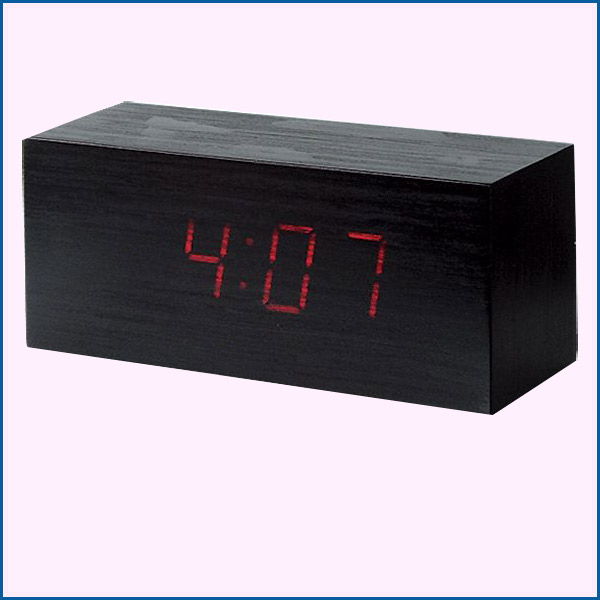 Clock with alarm block of wood